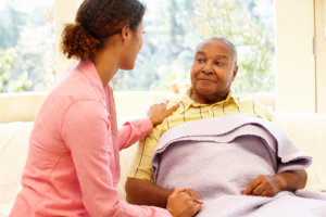 nurse assisiting a patient with Alzheimer's or Dementia